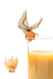 Yellow juice in glass decorated with Physalis,isolated Royalty Free Stock Photos