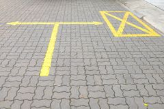 The yellow junction mark on the concrete floor. royalty free stock photos