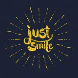 Yellow Just Smile Texts with Rays on Gray Royalty Free Stock Photos