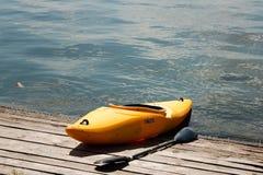 Yellow kaiak on the shore of lake Herastrau Royalty Free Stock Photo