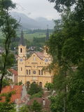 Yellow katholic curch in brunico Stock Photo