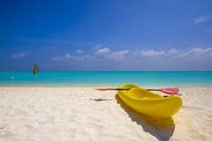 Yellow kayak at the beach Stock Images