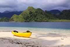Yellow kayak on the beach of exotic tropical island
