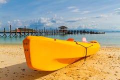 Yellow kayak on beach Stock Photos