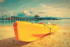 Yellow kayak on beach Stock Image