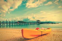 Yellow kayak on beach Stock Photography