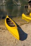 Yellow kayak on lake Stock Photos