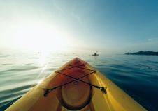 Yellow kayak lake royalty free stock image