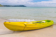 Yellow kayak on the sand beach Stock Image