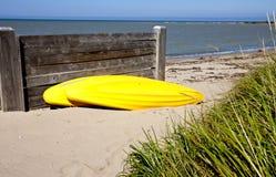 Yellow Kayak on shore Stock Image