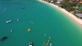 Yellow Kayaks Group on Beautiful Clear Sea Water. HD Aerial View Shot. Phuket, Thailand. stock video footage