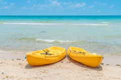 .Yellow kayaks on white sand beach. Yellow kayaks on white sand beach Royalty Free Stock Photography