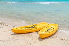 .Yellow kayaks on white sand beach. Yellow kayaks on white sand beach Royalty Free Stock Image