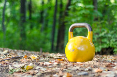Yellow kettle bell Stock Photos