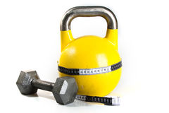 Yellow Kettlebell. Close up of a yellow kettlebell on a white background Royalty Free Stock Photography