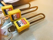 Yellow key lock and tag for process cut off electrical,the toggle t stock image