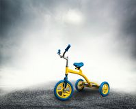 Yellow kid's bicycle Stock Images