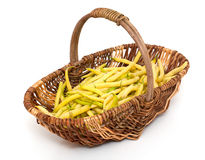 Yellow kidney beans in a basket. Isolated on white Royalty Free Stock Photos