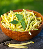 Yellow kidney beans in a bowl. On wooden table Stock Image