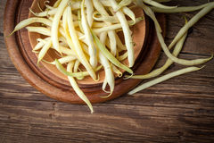 Yellow kidney beans in a bowl. Yellow kidney beans in a bowl on wooden table Royalty Free Stock Image