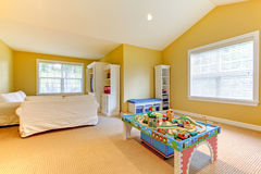 Yellow kids play room with white sofa. Stock Photography