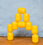Yellow kinder eggs, Russian D letter Stock Photo