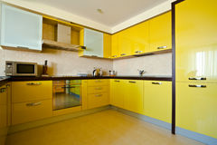 Yellow kitchen interior Royalty Free Stock Images