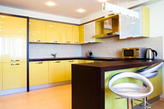 Yellow kitchen interior Stock Image