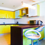 Yellow kitchen interior Royalty Free Stock Photo