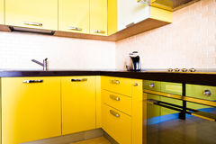 Yellow kitchen interior Stock Photography