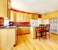 Yellow kitchen with island and yellow wood. Stock Image