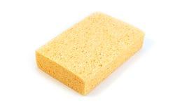 Yellow kitchen sponge. On white background stock photo