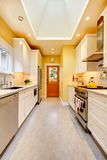 Yellow kitchen with white cabinets and stove. Stock Images