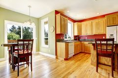 Yellow kitchen with wood and red and green colors. Stock Photos