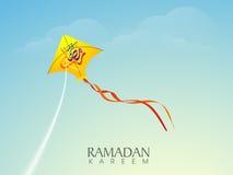 Yellow kite with Arabic text for Ramadan Kareem. Stock Photos