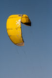 Yellow kite on blue sky background Royalty Free Stock Images
