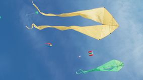 Free Yellow Kite With Two Tails In Flight Against Blue Sky And Sunny Day Royalty Free Stock Photography - 93730027