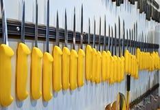 Yellow knife heap, modern industry,. Focus on center. yellow knife heap, modern industry details Stock Photo