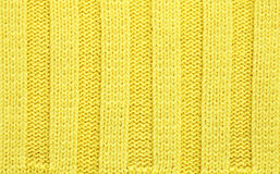 Yellow knitted fabric textured background Stock Images