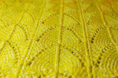 Yellow knitted pattern Royalty Free Stock Image