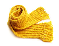 Yellow knitted scarf. Knitted yellow scarf with fringe on white background Royalty Free Stock Photos