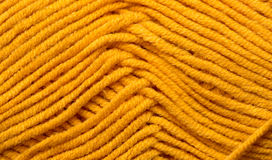 Yellow knitted texture Stock Images