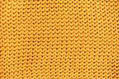 Yellow knitted texture. Wool yarn in knitting background Royalty Free Stock Images