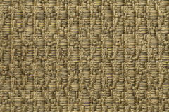 Yellow knitted woolen background with a pattern of soft, fleecy cloth. Texture of gold textile closeup. Royalty Free Stock Images
