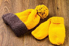 Yellow knitting cap and mittens Stock Photo