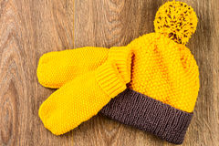Yellow knitting cap and mittens Stock Image