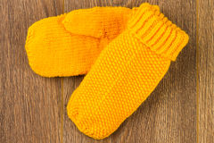 Yellow knitting mittens Royalty Free Stock Images