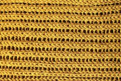 Yellow knitting texture background, mustard color knitted wool stock photos