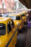 Yellow Kolkata taxis outside Howrah Railway Station, India Royalty Free Stock Image