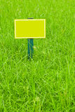 Yellow label. On the grass royalty free illustration